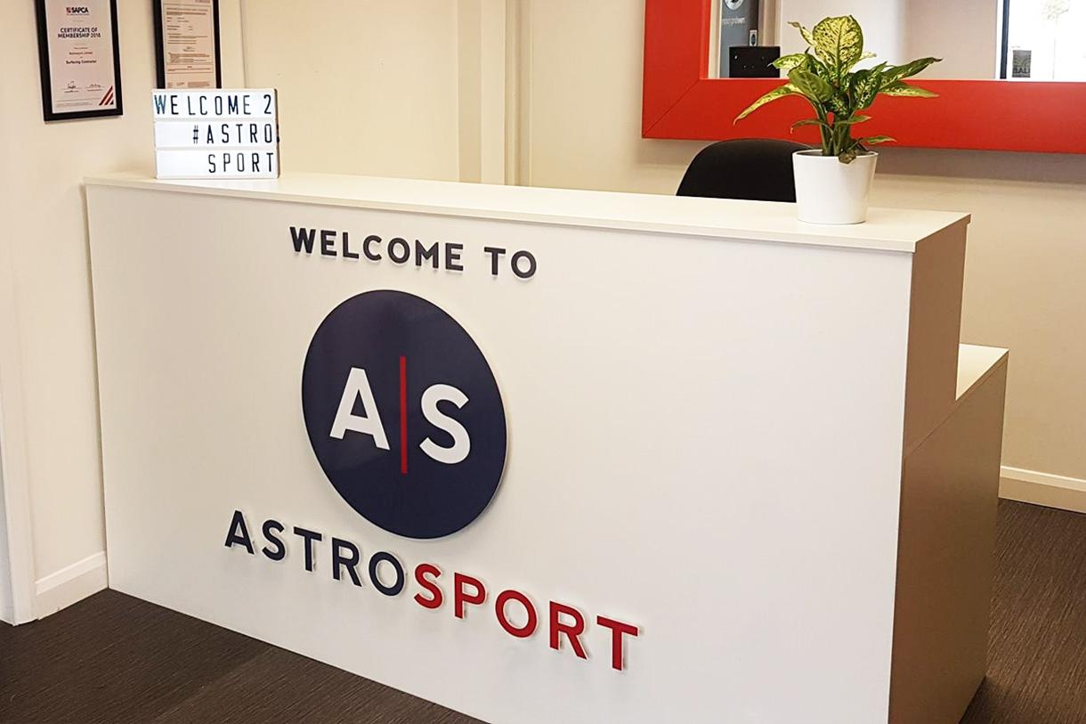 Astrosport front desk sign